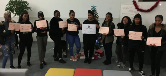 10 Sister System graduates with their certificates