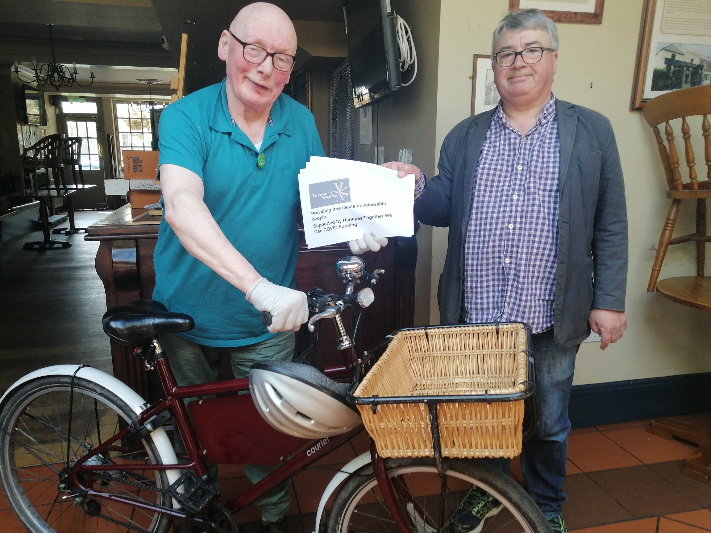 Food delivery volunteer with bicycle ready to distribute meals ot vulnerable people