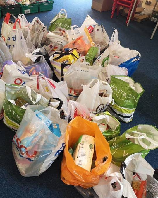 Shopping bags of food and provisions donated by the public