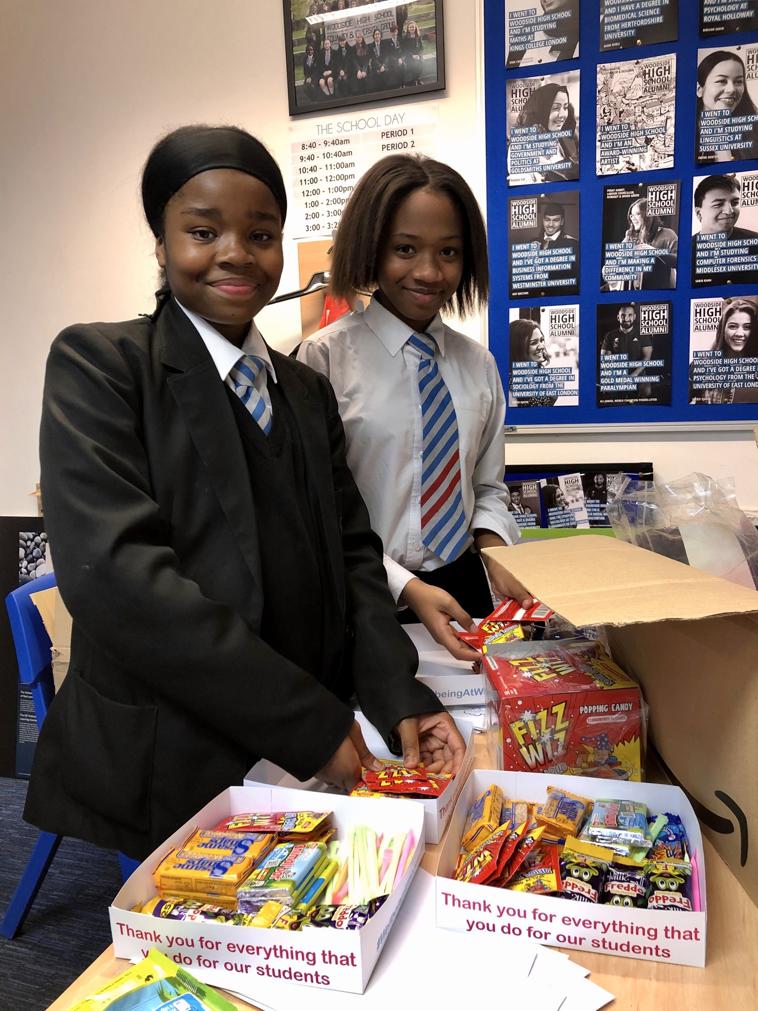 Two students taking in deliveries of snacks for the Food Bank