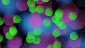 Blurred image of purple, green and pinck lights