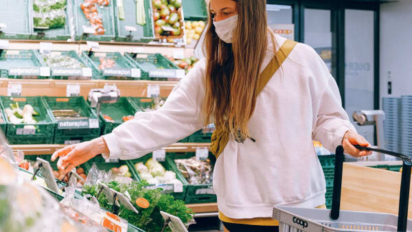 Photo by Anna Shvets from Pexels; woman with face mask shopping in supermarket