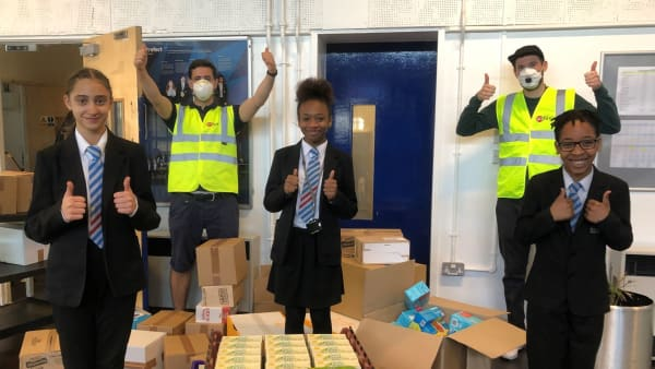 Students from Woodside High giving donations the thumbs up